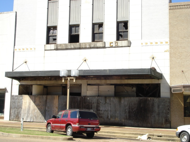 A vehicle sits in front of a building in the Brownfields Program