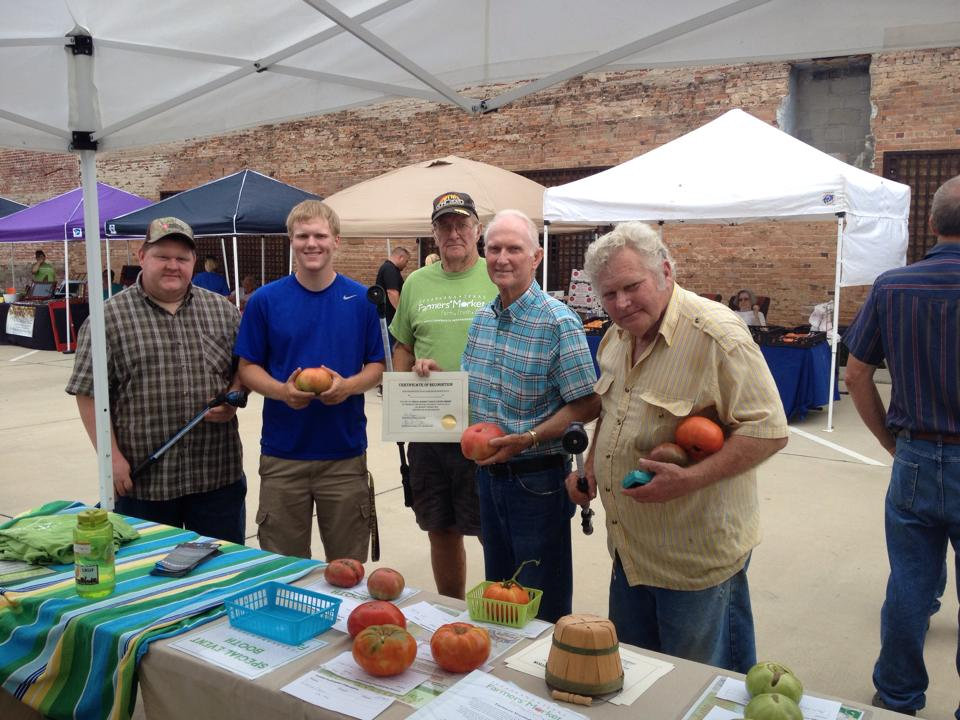 Group of men at the Farmers' Market