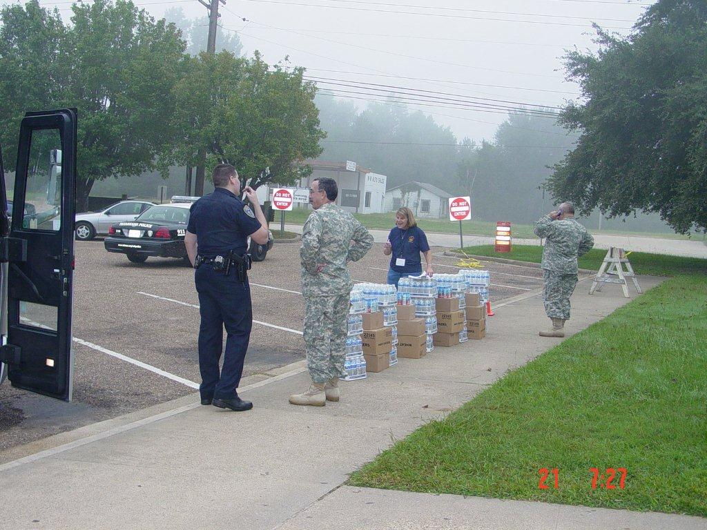 Military and police personnel set up shelter and supplies for people stuck in Hurricane Ike.