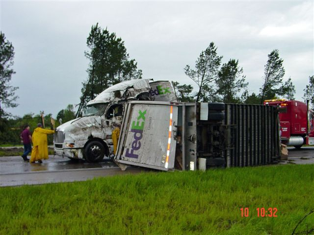 Semi-Trucks blown over and into each other on the road.