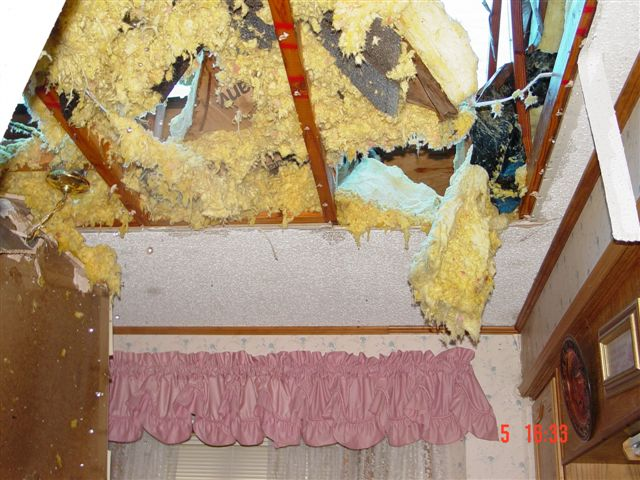 Insulation exposed from the ceiling following the storm.