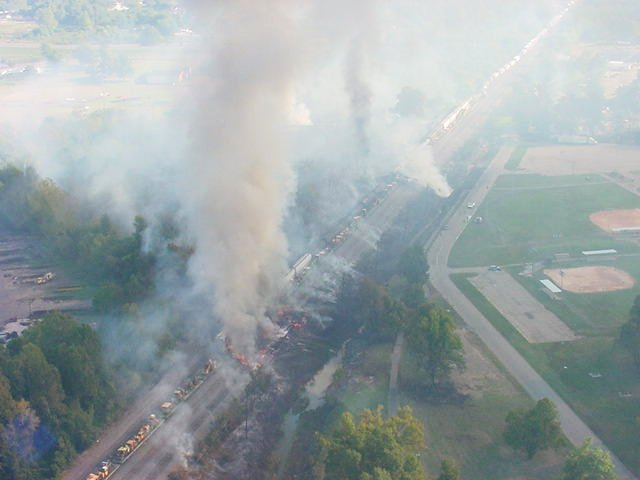 Overhead view of the smoking scene of the train derailment.