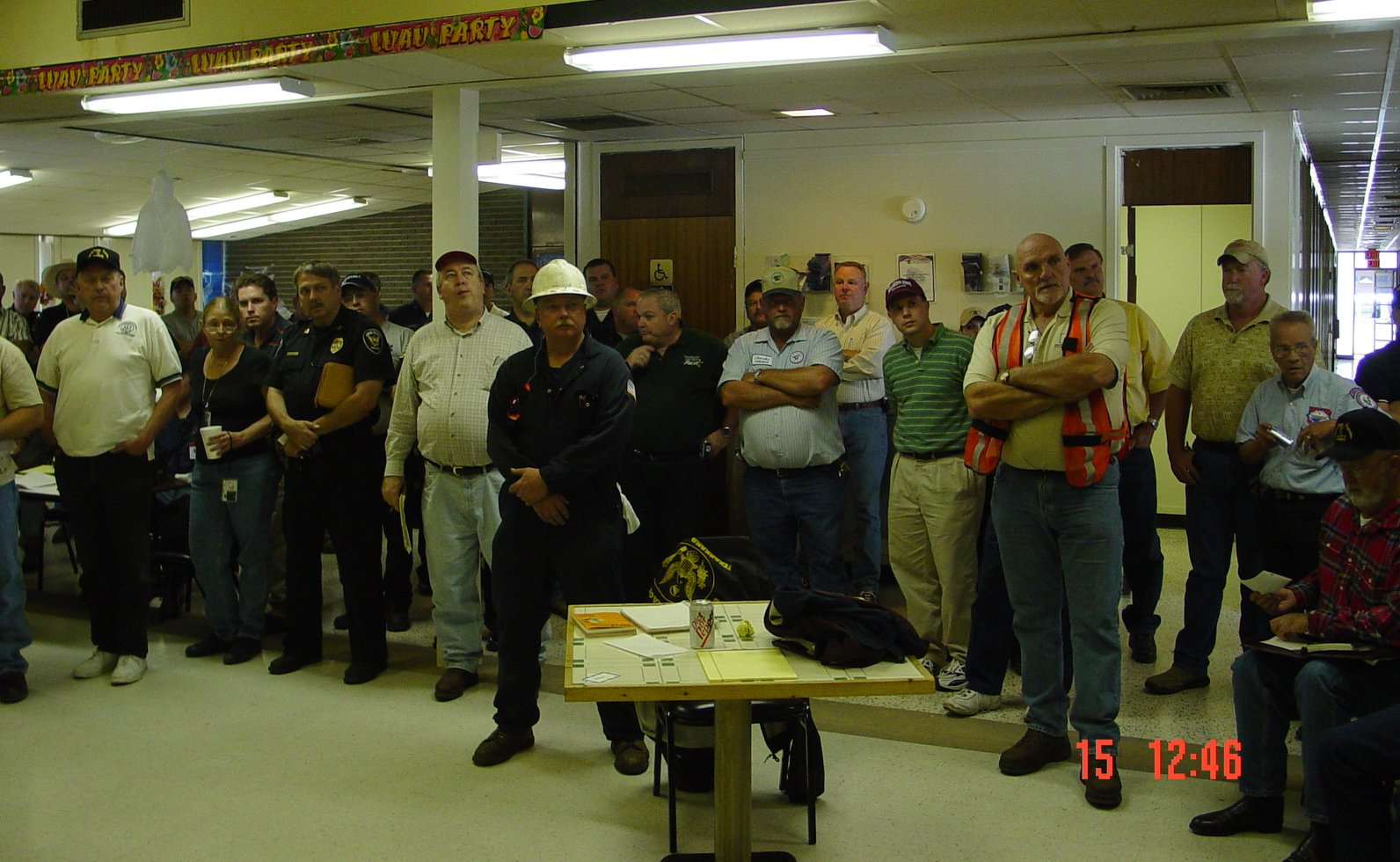 Emergency personnel meet in a building to discuss the best course of action.