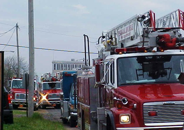 A long line up of fire trucks at the training day.