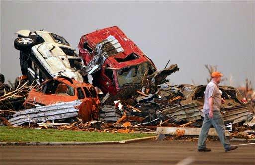 Pile of cars thrown by the tornado.