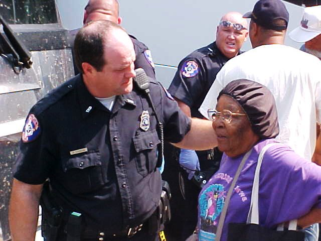 A police officer greets a civilian arriving to the shelter.