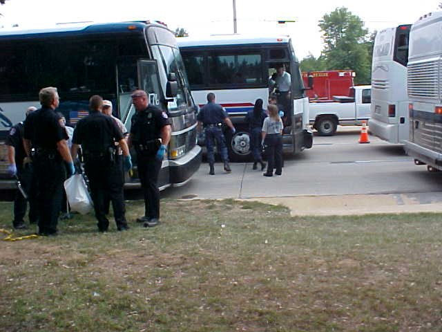 People coming off the buses to the shelter.